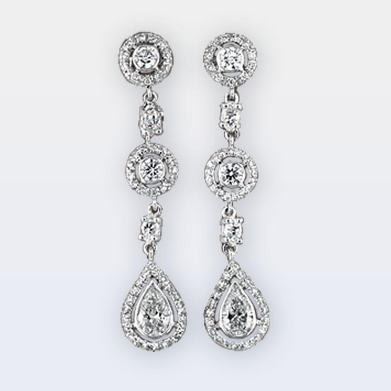 Dangle diamond earrings with round brilliant cut diamonds and pear diamond drops