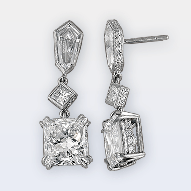 Platinum dangle earrings with shield cut and princess cut diamonds
