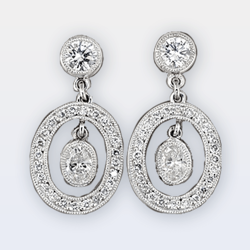 Oval drop earrings with oval center stone and pave diamond frame