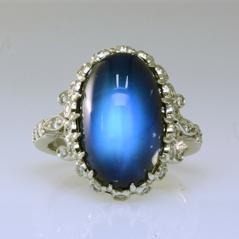Oval moonstone ring with diamonds