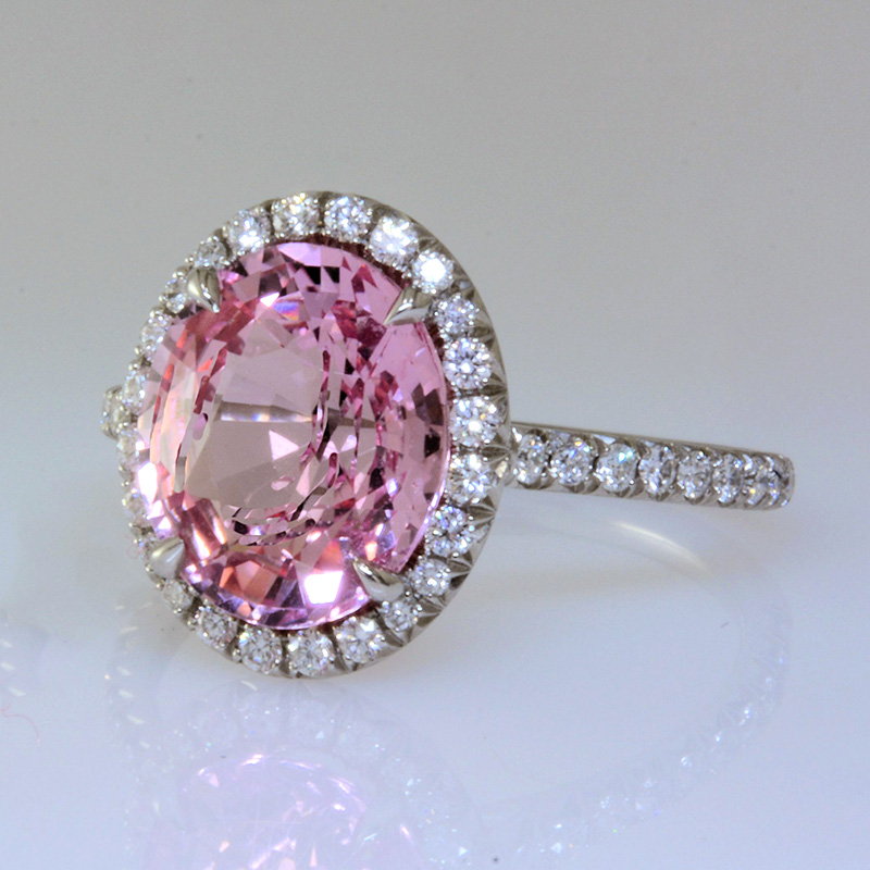 Padparadscha sapphire ring with diamond halo and shank