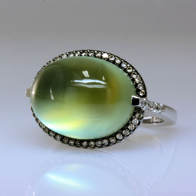 Oval east west prehnite ring with diamond halo