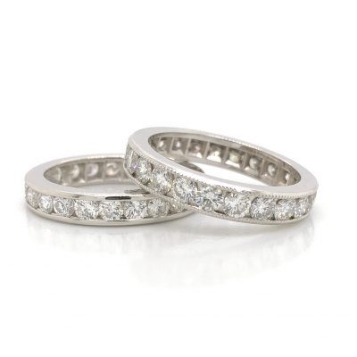 Channel-set round diamond eternity bands with and without milgrain