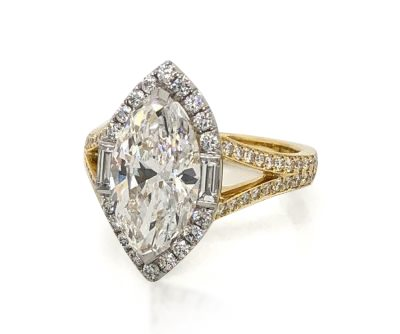 White and yellow gold engagement ring with marquise center stone and diamond halo