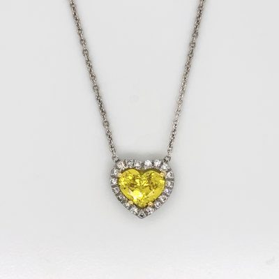 Yellow heart sapphire necklace with diamond halo