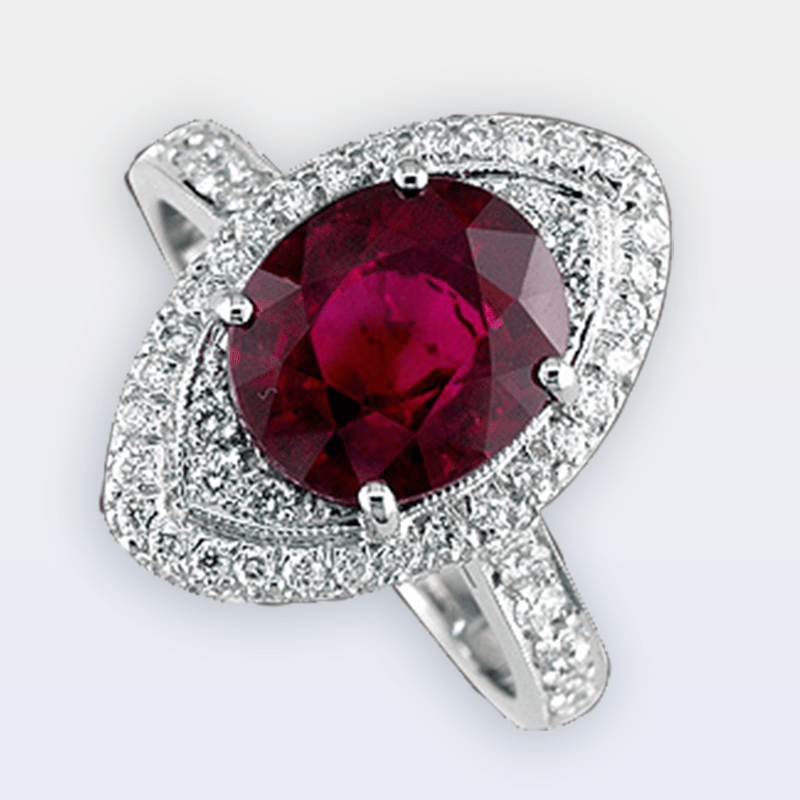 Gorgeous oval ruby set in a pave diamond marquise-shaped setting.