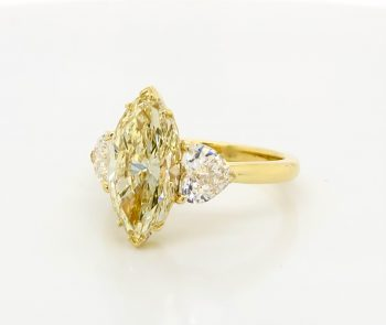 Yellow Diamond Marquise Ring with Heart Side Stones