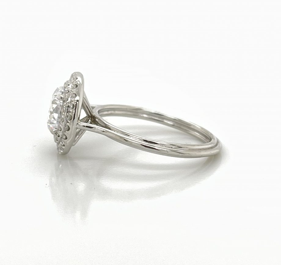 Custom engagement ring featuring a round diamond with a double halo