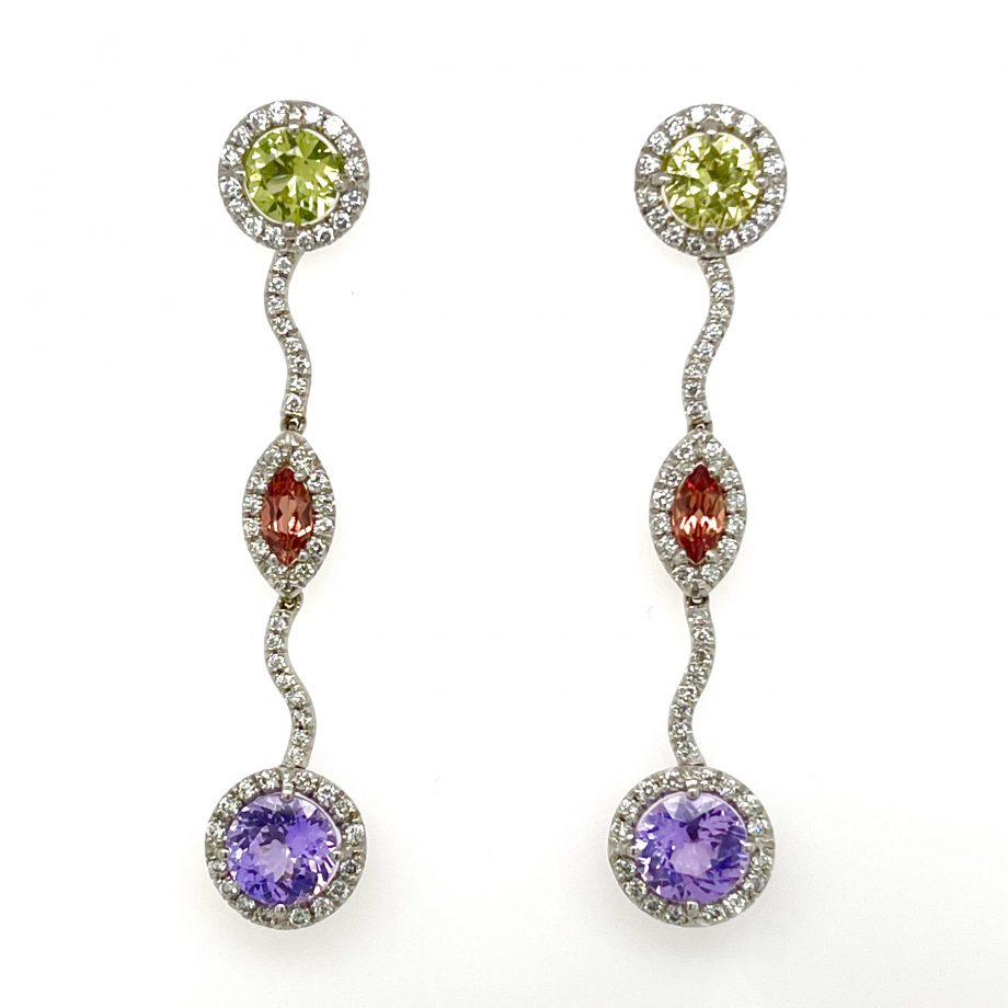 Handcrafted dangle earrings featuring green, orange, and violet sapphires with diamonds details