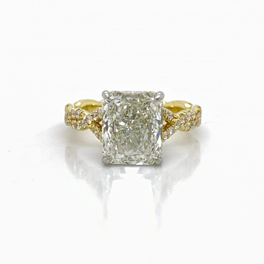 radiant-cut diamond engagement ring with a twisted band and diamond details in the gallery