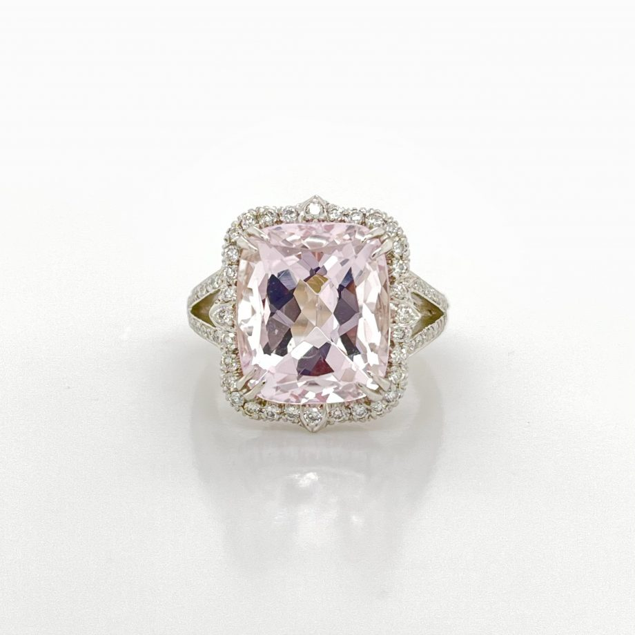 cushion-cut morganite ring with a diamond halo and split shank