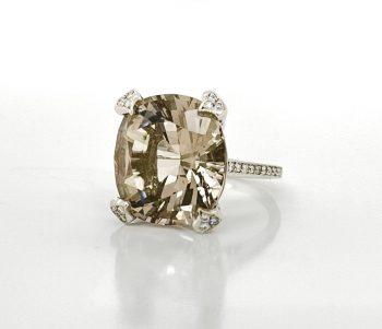 Handmade large smoky quartz ring featuring diamond pave prongs