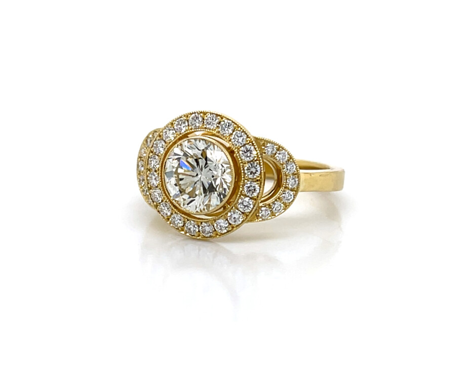 Round 18k yellow gold engagement ring with diamond halo and buckles