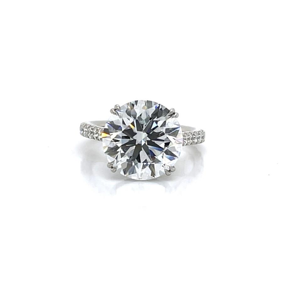 Round diamond engagement ring with diamond band