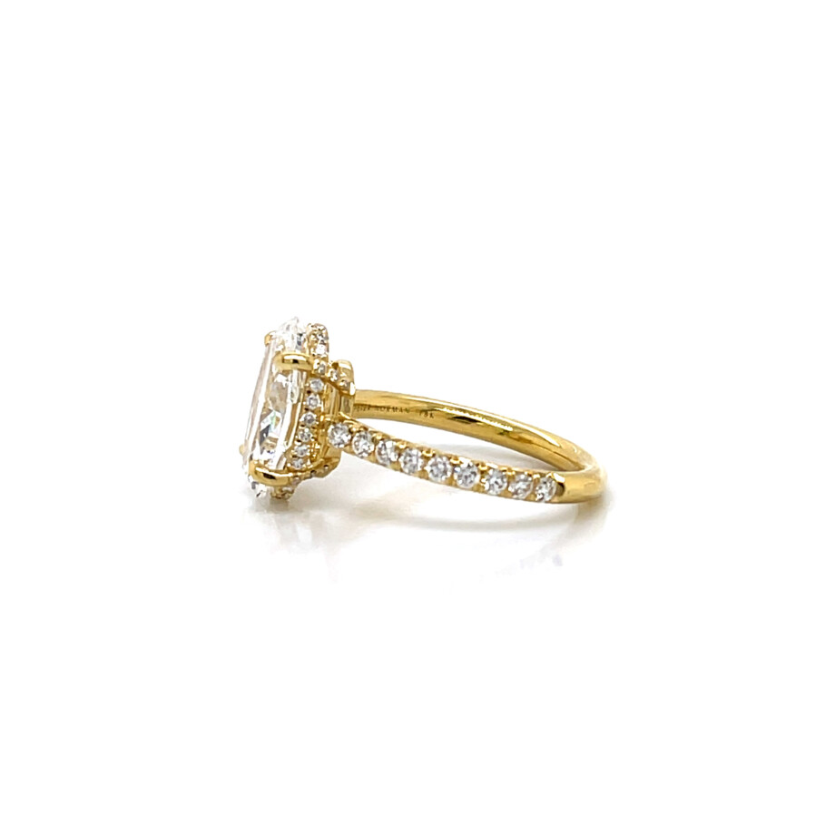18k yellow gold diamond oval engagement ring with a diamond band
