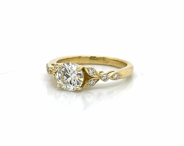 Round Diamond Engagement Ring with Marquise-Shaped Details