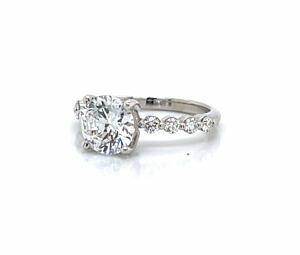 Round Brilliant-Cut Diamond Engagement Ring with Round Side Stones