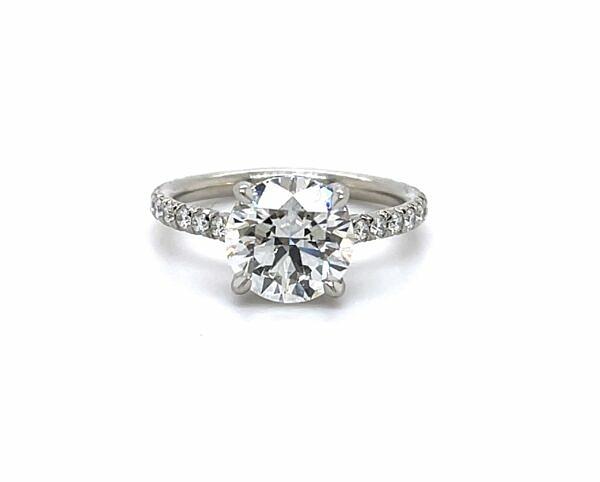 Round diamond engagement ring with diamond band and diamond prongs